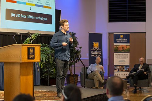 Man explaining business plan on stage during challenge